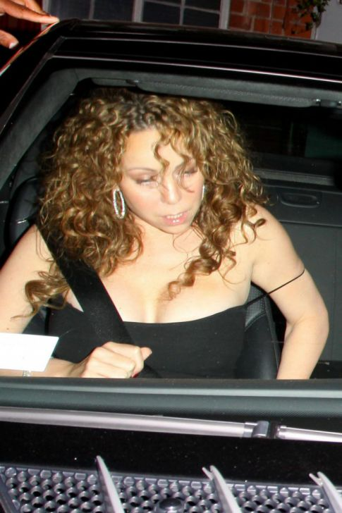 Mariah Carey Brings Back Her 90s Hair, Falls Out Of Her Dress