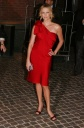 Charlize Theron Rocks the Red Toga Look