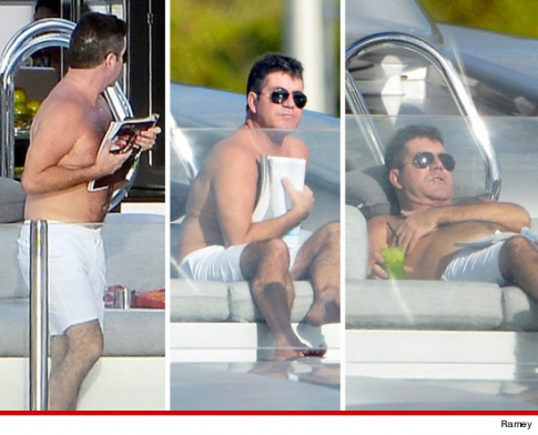 Simon Cowell covers man boobs on holiday!