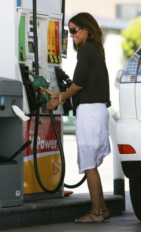 Halle Berry Holding Baby and Pumping Gas, Multitasking