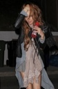 Lindsay Lohan Looks a Bit Disheveled, Single